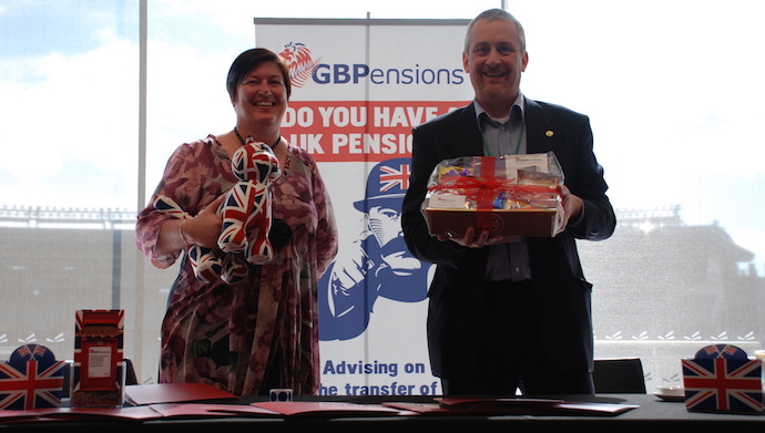 Pictured here are Christina Overwater of the NZAMI (holding Camilla, GBPensions' office cat) and Tony Chamberlain with the hamper of lollies.